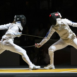 Vezzali of Italy and Maitrejean of France compete during their quarter final women's foil event at the World Fencing Championships in Catania